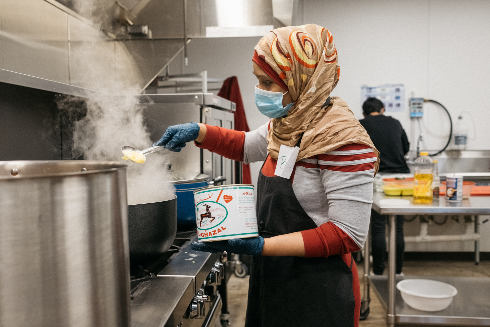 BADUR MOHAMED, REFUGEE AND CHEF FOR WELCOME NEIGHBOR STL'S SUPPER CLUB.